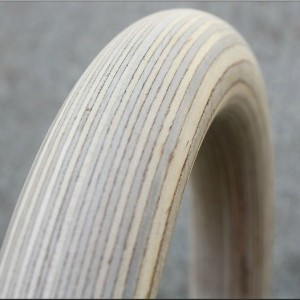 a close up showing the grain on a pair of birch gymnastic rings