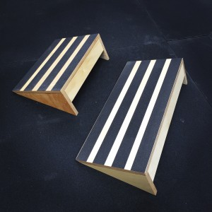 2 angled slant boards positioned on a rubber floor