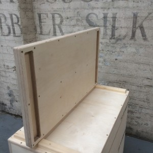 a jerk block lid on its side showing its construction