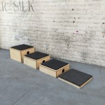 4 stackable plyo boxes in front of a brick background