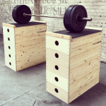 a set of jerk blocks with a loaded barbell on top