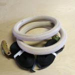 a Pair of birch gymnastic rings on a table