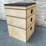 a varnished stack of wooden boxes